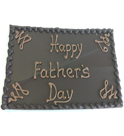 Chocolate plaque with happy fathers day in icing